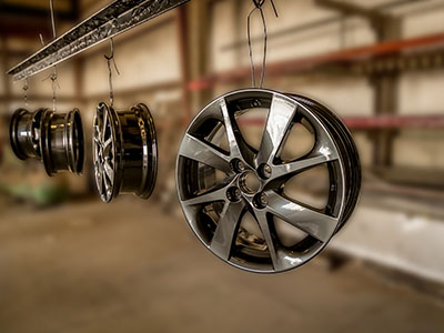 Aluminum Rims hanging after being powder coated